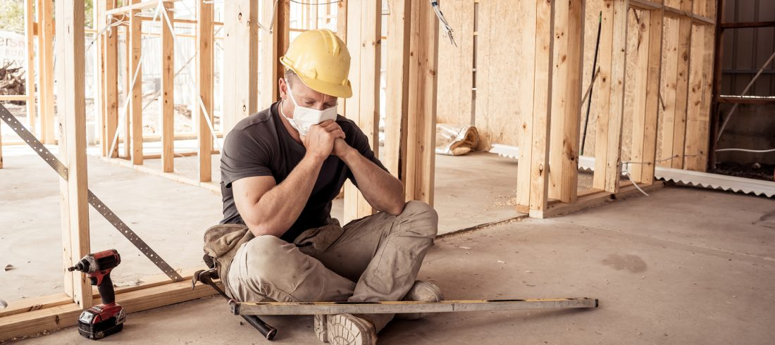 Man in construction site with face mask