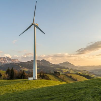 Wind turbine in a field with mountains