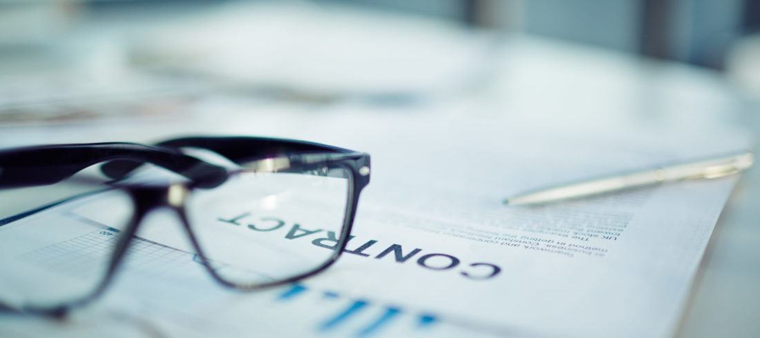 Business contract with glasses