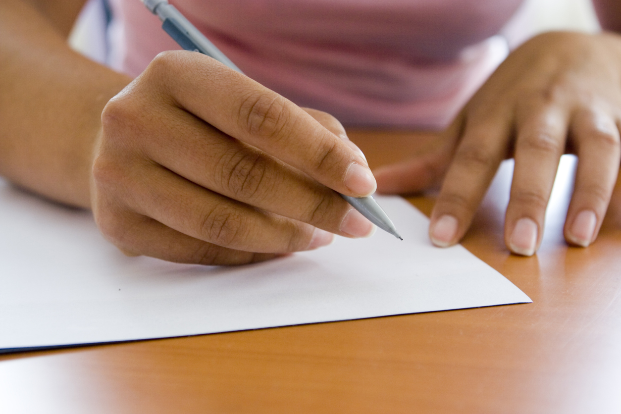 writing letter with pen and paper