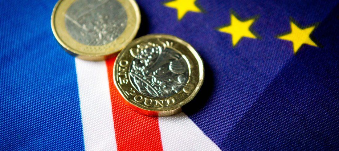 Pound coins on UK & EU flag