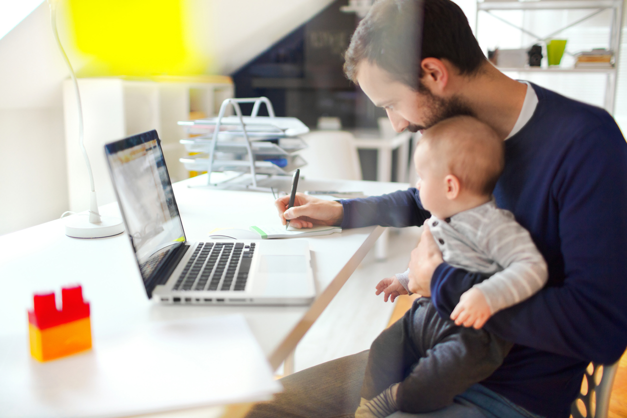 Working father with baby